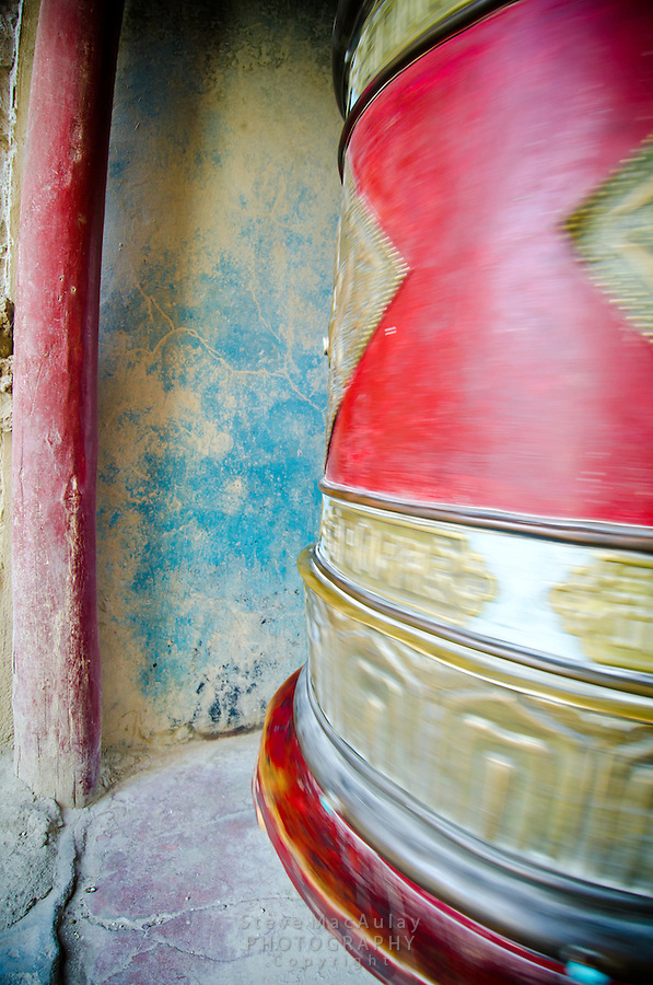 Large spinning prayer wheel, Shey Palace, Naropa Royal Palace, in Ladakh, India.