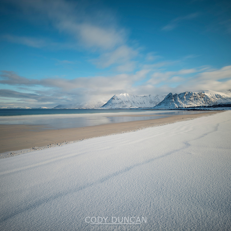 Winter snow covers sandy beach, Gimsøy, Lofoten Islands, Norway