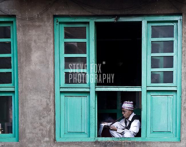 Old man reading his paper, Kathmandu, Nepal