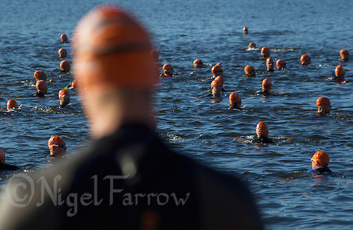 25 AUG 2013 - STOCKHOLM, SWE - A competitor prepares to enter the water for his wave start of the Stockholm Triathlon in Stockholm, Sweden (PHOTO COPYRIGHT © 2013 NIGEL FARROW, ALL RIGHTS RESERVED)