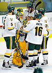 12 December 2009: University of Vermont Catamount goaltender Rob Madore, a Sophomore from Venetia, PA, is congratulated by teammates after a game against the St. Lawrence University Saints at Gutterson Fieldhouse in Burlington, Vermont. Madore made 21 saves to earn his second career shutout as the Catamounts defeated their former ECAC rival Saints 3-0. Mandatory Credit: Ed Wolfstein Photo