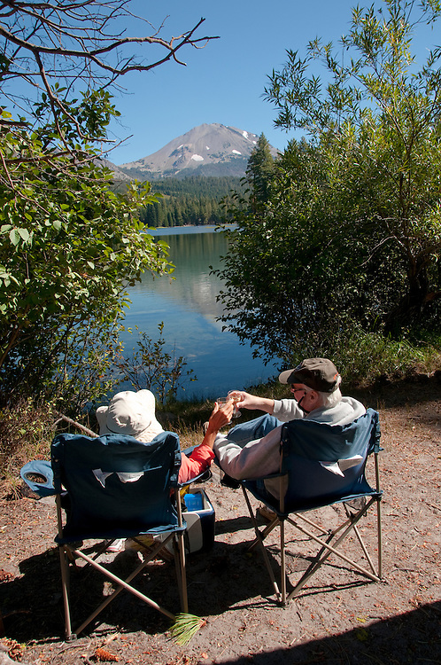 Couple relaxing at Lassen Peak and Manzanita Lake in the Shasta region of Northern California.Photo copyright Lee Foster.  Photo # california-lassen-park-cashas105327