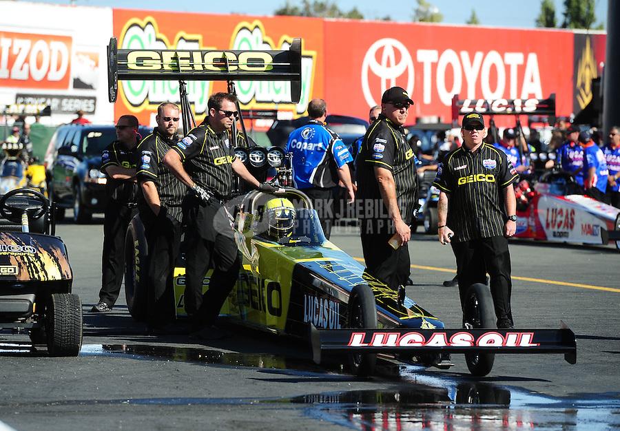 Jul. 29, 2011; Sonoma, CA, USA; NHRA top fuel dragster crew members for driver Morgan Lucas during qualifying for the Fram Autolite Nationals at Infineon Raceway. Mandatory Credit: Mark J. Rebilas-US PRESSWI