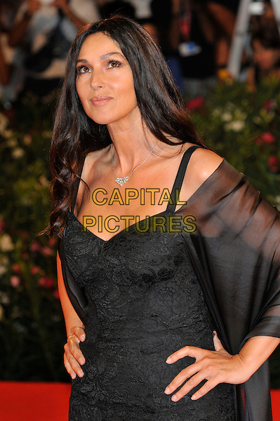 Monica Bellucci.attends 'Un Ete Brulant' Premiere at Palazzo del Cinema during the 68th Venice Film Festival, Venice, Italy, September 2nd, 2011..half length sleeves dress wrap shawl silver necklace black straps hands on hips side looking up upwards lace .CAP/PL.©Phil Loftus/Capital Pictures.