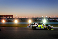 Nov. 16, 2008; Homestead, FL, USA; NASCAR Sprint Cup Series driver Jimmie Johnson races down the backstretch during the Ford 400 at Homestead Miami Speedway. Mandatory Credit: Mark J. Rebilas-
