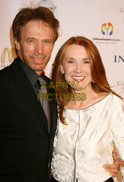 JERRY BRUCKHEIMER & WIFE.2nd Annual Noche de Ninos Gala benefiting Children's Hospital Los Angeles held at the Beverly Hilton Hotel, .Beverly Hills, California, USA,.07 October 2006..half length married husband.Ref: ADM/RE.www.capitalpictures.com.sales@capitalpictures.com.©Russ Elliot/AdMedia/Capital Pictures.