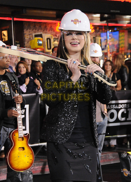 ORIANTHI (Orianthi Panagaris).TThe Hard Rock Cafe Hollywood's grand opening party in Hollywood, California, USA..October 21st, 2010.half length guitar dress hat goggles white hard hat black.CAP/RKE/DVS.©DVS/RockinExposures/Capital Pictures.
