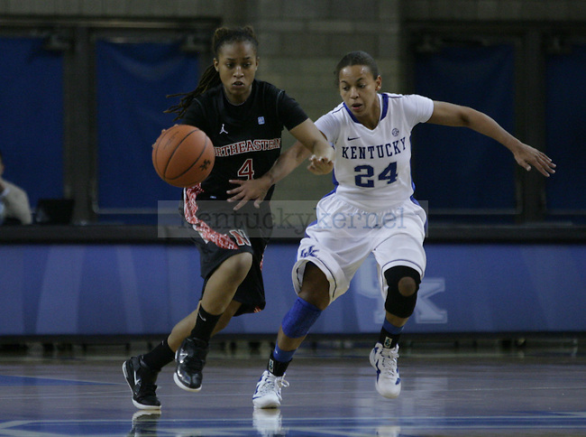 Senior point guard Amber Smith runs after a member of Northeastern during the first half of UK Women's Basketball game vs. Northeastern at Memorial Coliseum in Lexington, Ky., on Thursday, Nov. 17, 2011. Photo by Tessa Lighty | Staff