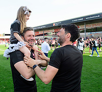 Lincoln City manager Danny Cowley, right, and Lincoln City's assistant manager Nicky Cowley celebrate after winning the league<br /> <br /> Photographer Chris Vaughan/CameraSport<br /> <br /> The EFL Sky Bet League Two - Lincoln City v Tranmere Rovers - Monday 22nd April 2019 - Sincil Bank - Lincoln<br /> <br /> World Copyright © 2019 CameraSport. All rights reserved. 43 Linden Ave. Countesthorpe. Leicester. England. LE8 5PG - Tel: +44 (0) 116 277 4147 - admin@camerasport.com - www.camerasport.com