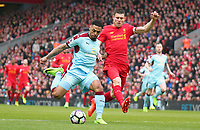 Burnley's Andre Gray under pressure from Liverpool's James Milner<br /> <br /> Photographer Rich Linley/CameraSport<br /> <br /> The Premier League - Liverpool v Burnley - Sunday 12 March 2017 - Anfield - Liverpool<br /> <br /> World Copyright &copy; 2017 CameraSport. All rights reserved. 43 Linden Ave. Countesthorpe. Leicester. England. LE8 5PG - Tel: +44 (0) 116 277 4147 - admin@camerasport.com - www.camerasport.com