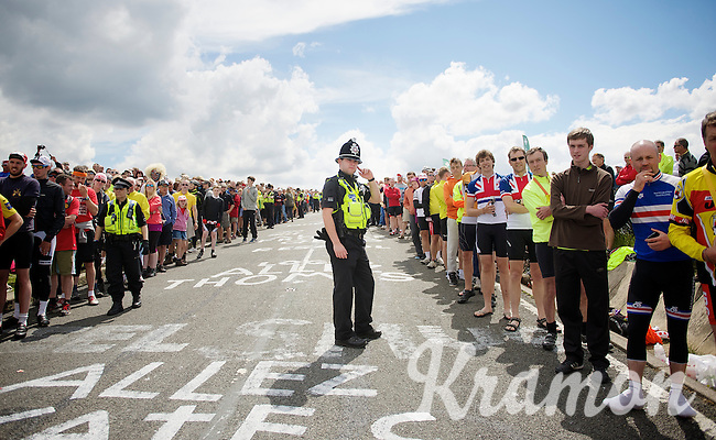 bobby cop controlling the crowds (a bit)<br /> <br /> 2014 Tour de France<br /> stage 2: York-Sheffield (201km)