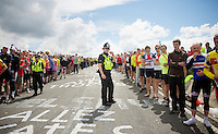 bobby cop controlling the crowds (a bit)<br /> <br /> 2014 Tour de France<br /> stage 2: York-Sheffield (201km)