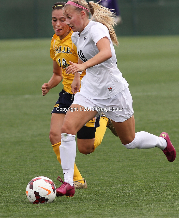 Penn State Taylor Schram (19) against La Salle's Gabriella Carbone (19) on Sept. 1, 2013. No. 9 Penn State won 5-1. Photo/©2013 Craig Houtz