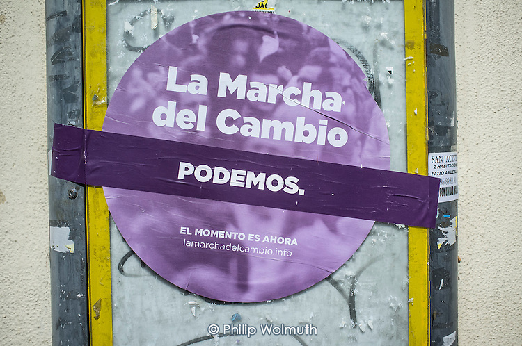 Change Begins in Andalucia.  Podemos poster, Seville, Spain. The grassroots party is expected to make major gains in the first in a forthcoming round of regional elections.