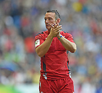 Wales's Gareth Davies during a lap of honour at the end of the game<br /> <br /> Wales Vs England - men's classification 5th - 6th place match<br /> <br /> Photographer Chris Vaughan/CameraSport<br /> <br /> 20th Commonwealth Games - Day 4 - Sunday 27th July 2014 - Rugby Sevens - Ibrox Stadium - Glasgow - UK<br /> <br /> © CameraSport - 43 Linden Ave. Countesthorpe. Leicester. England. LE8 5PG - Tel: +44 (0) 116 277 4147 - admin@camerasport.com - www.camerasport.com