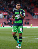 Swansea City's Jefferson Montero salutes the travelling fans during the Barclays Premier League match between Stoke City and Swansea City played at Britannia Stadium, Stoke on April 2nd 2016