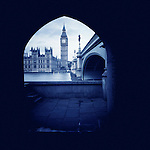 Houses of Parliament and Big Ben seen through arch, Westminster, London, UK