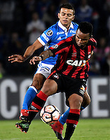 BOGOTA- COLOMBIA – 08-02-2017: John Duque (Izq.) jugador de Millonarios de Colombia, disputan el balon con Carlos Alberto (Der.) jugador de Atletico Paranaense de Brasil, durante partido entre Millonarios de Colombia y Atletico Paranaense de Brasil, por la segunda fase, llave 1 de la Copa Conmebol Libertadores Bridgestone 2017, en el estadio Nemesio Camacho El Campin, de la ciudad de Bogota. / John Duque (L) player of Millonarios of Colombia, fights for the ball with Carlos Alberto (R) player of Atletico Paranaense of Brasil, during a match between Millonarios of Colombia and Atletico Paranaense of Brasil, for the second phase, key1, of the Conmebol Copa Libertadores Bridgestone 2017 at the Nemesio Camacho El Campin in Bogota city. VizzorImage / Luis Ramirez / Staff.
