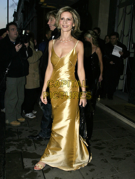 JULIA CARLING.Leaving Claridges Hotel, London, .February 12th 2005..full length gold satin dress.Ref: AH.www.capitalpictures.com.sales@capitalpictures.com.©Capital Pictures.