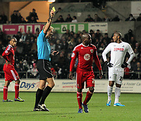 ATTENTION SPORTS PICTURE DESK<br /> Pictured L-R: Referee G D Scott shows a yellow card to Jamal Campbell-Ryce of Bristol for his foul against Nathan Dyer of Swansea (not pictured)<br /> Re: npower Championship, Swansea City FC v Bristol City Football Club at the Liberty Stadium, south Wales. Wednesday 10 November 2010