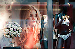 "Window display at Marks and Spencer for..Rosie Huntington-Whitely.At M&S Oxford St.to promote her new range of underwear - lingerie -.""Rosie for Autograph."".On the way in she paused to kiss strange long haired blonde man.....Pic by Gavin Rodgers/Pixel 8000 Ltd"