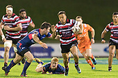 Tim Nanai-Williams tries to avoid Timothy O'Malley. Mitre 10 Cup game between Counties Manukau Steelers and Tasman Mako's, played at ECOLight Stadium Pukekohe on Saturday October 14th 2017. Counties Manukau won the game 52 - 30 after trailing 22 - 19 at halftime. <br /> Photo by Richard Spranger.