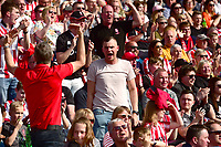 Lincoln City fans watch their team in action<br /> <br /> Photographer Chris Vaughan/CameraSport<br /> <br /> The EFL Sky Bet League Two - Carlisle United v Lincoln City - Friday 19th April 2019 - Brunton Park - Carlisle<br /> <br /> World Copyright © 2019 CameraSport. All rights reserved. 43 Linden Ave. Countesthorpe. Leicester. England. LE8 5PG - Tel: +44 (0) 116 277 4147 - admin@camerasport.com - www.camerasport.com