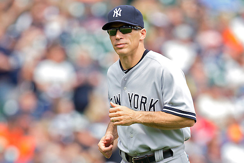 June 03, 2012:  New York Yankees manager Joe Girardi (28) runs back to the dugout after a mound conference during MLB game action between the New York Yankees and the Detroit Tigers at Comerica Park in Detroit, Michigan.  The Yankees defeated the Tigers 5-1.