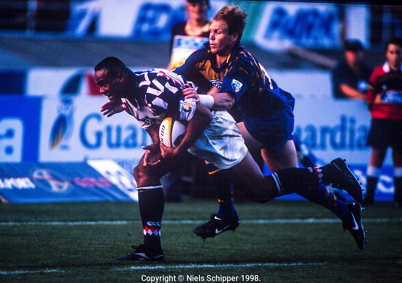 Jeff Wilson tries to stop Jonah Lomu in the Super Rugby match between the Blues and Highlanders at Eden Park, Auckland, New Zealand on 23 May 1998. Photo: Niels Schipper / lintottphoto.co.nz