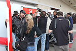Photographers and television crews crowd around Fernando Alonso (3) driver of the Scuderia Ferrari Marlboro Ferrari before the Formula 1 United States Grand Prix practice session at the Circuit of the Americas race track in Austin,Texas.