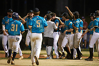 Sam Zayicek (33) (High Point) of the Mooresville Spinners is congratulated by his teammates after he was hit by a pitch to force in the winning run in the bottom of the ninth inning against the Lake Norman Copperheads at Moor Park on July 6, 2020 in Mooresville, NC.  The Spinners defeated the Copperheads 3-2. (Brian Westerholt/Four Seam Images)