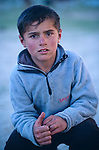 A young tajik boy gives a thumbs up sign in the Pamir mountains of Tajikistan.