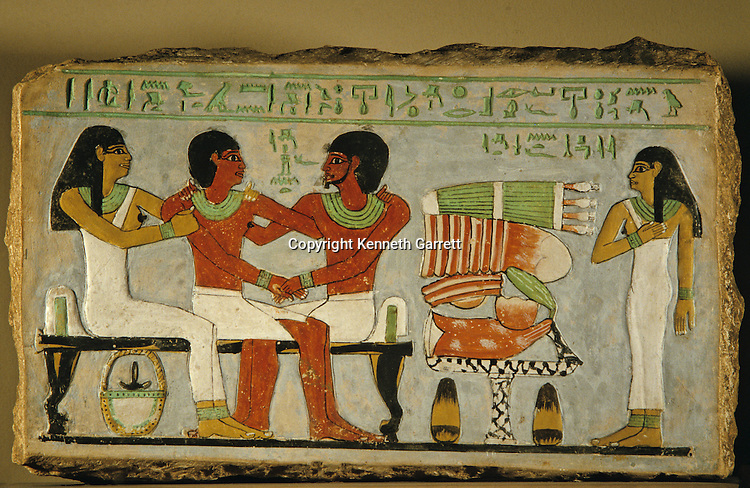 Amenemhet, embraced by father Inyotef, 11th dynasty official, and mother Iy. Wife, Hapy, stands behind food offering to Osiris, Middle Kingdom, Egyptian Museum, Cario