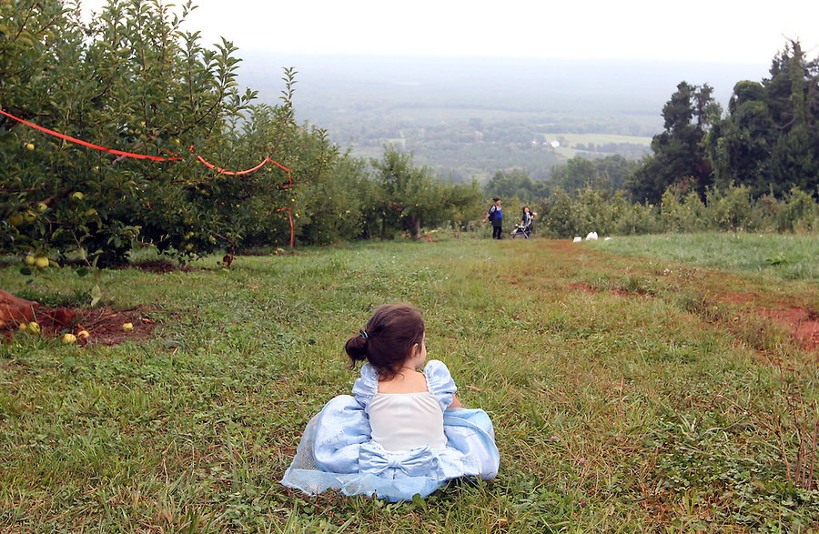 Ava at Carters Mountain Apple Orchard in Cinderella dress. Photo/Andrew Shurtleff