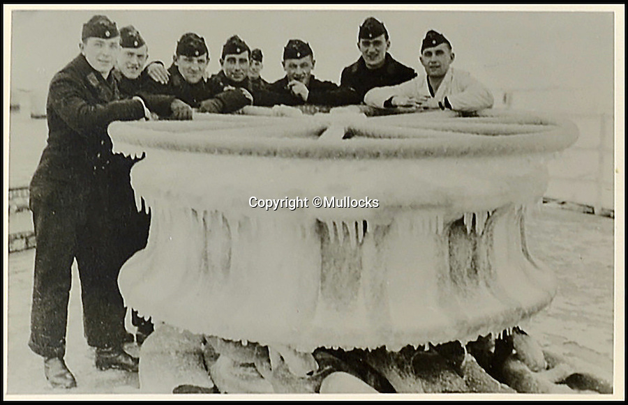 BNPS.co.uk (01202 558833)<br /> Pic: Mullocks/BNPS<br /> <br /> Sailor endure the winter of 1939.<br /> <br /> A German sailor's personal photo album capturing Hitler's visit to his doomed ship on which almost 2,000 men later perished has emerged for the first time. <br /> <br /> Showing the Fuhrer inspecting the ill-fated crew and greeting senior personnel, the 81 images were taken on board the infamous Nazi battleship Scharnhorst between 1939 and 1940. <br /> <br /> The 771ft vessel was sunk during the Battle of the North Cape in 1943 by HMS Duke of York with only 36 of a crew of 1,968 surviving. <br /> <br /> And this album, compiled by an unidentified German sailor, shows what life was like on Scharnhorst before that day. It will be sold by Mullocks Auctions in Shropshire on October 18 with a £650 estimate.