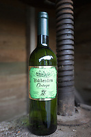 Bottle of white wine Ortega and old wine press at Biddenden English Vineyards in Kent, England, UK