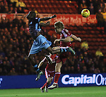Modou Sougou of Sheffield Wednesday and Adam Clayton of Middlesbrough in the air after both missing the ball - Sky Bet Championship - Middlesbrough vs Sheffield Wednesday - Riverside Stadium - Middlesbrough - England - 28th of December 2015 - Picture Jamie Tyerman/Sportimage