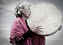 Susana Tapia, a midwife, grandmother and spiritual teacher, drums and sings during a cermony outside Quito, Ecuador.