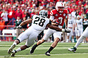29 October 2011: Taylor Martinez #3 of the Nebraska Cornhuskers rushing for five  yards on the play against the Michigan State Spartans in the first quarter at Memorial Stadium in Lincoln, Nebraska.  Nebraska defeated Michigan State 24 to 3.