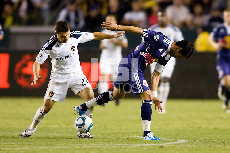LA Galaxy midfielder Dema Kovalenko defends his ground against Juan Pablo Angel forward of the New York Red Bulls. The New York Red Bulls beat the LA Galaxy 2-0 at Home Depot Center stadium in Carson, California on Friday September 24, 2010.