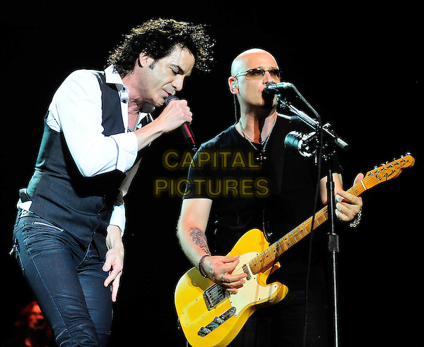 Train -  Patrick Monahan, Jimmy Stafford.SHOW-ME Music and Arts Festival, a three-day extravaganza featuring some of today's top musical acts held at Springfield Underground Inc., Springfield, MO, USA..June 18th, 2011.stage concert live gig performance music half length singing white shirt grey gray waistcoat black t-shirt singing guitar.CAP/ADM/RP.©Ryan Pavlov/AdMedia/Capital Pictures.