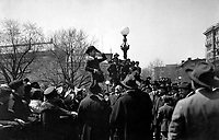 "Charlie Chaplin, comedy star of the ""movies"", making his first speech for the third Liberty Loan in front of the State, War and Navy Bldg, Washington D.C., on first anniversary of U.S. entry into war.  April 6, 1918.  Lt. Edmond deBerri.   (Army)<br /> NARA FILE #:  111-SC-7268<br /> WAR & CONFLICT BOOK #:  516"