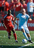 12 September 2009: Toronto FC defender Nana Attakora-Gyan #3 and Colorado Rapids forward Conor Casey #9 in action during MLS action at BMO Field Toronto in a game between Colorado Rapids and Toronto FC. .Toronto FC won 3-2..