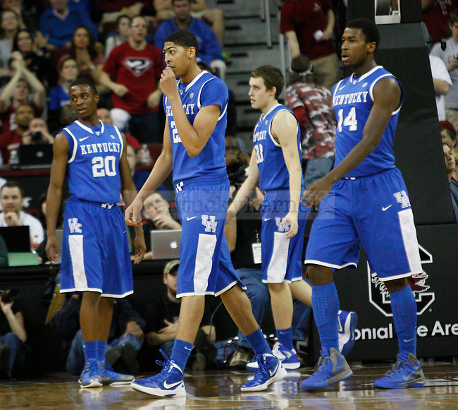 UK players head to the huddle for a timeout during the first half of the University of Kentucky Men's basketball game against University of South Carolina on 2/4/12 in Columbia, SC. Photo by Quianna Lige | Staff