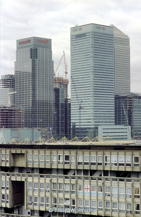 Canary Wharf offices tower above council flats in Blackwall, Tower Hamlets, East London.