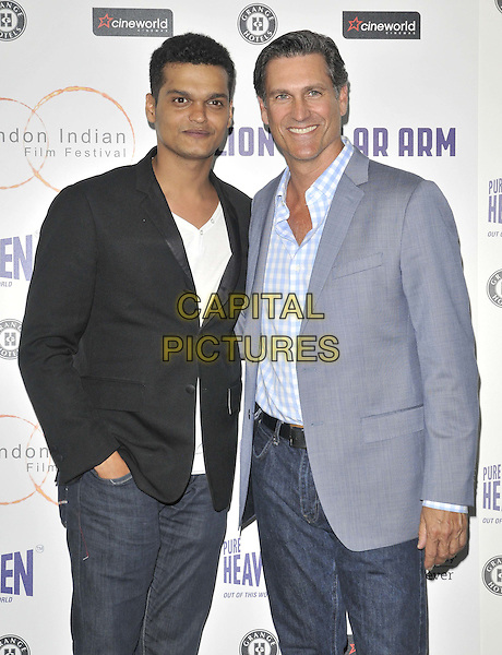 LONDON, ENGLAND - JULY 14: Madhur Mittal &amp; Mark Ciardi attend the London Indian Film Festival 'Million Dollar Arm' UK film premiere, Cineworld Shaftesbury Avenue cinema, Coventry St., on Monday July 14, 2014 in London, England, UK. <br /> CAP/CAN<br /> &copy;Can Nguyen/Capital Pictures