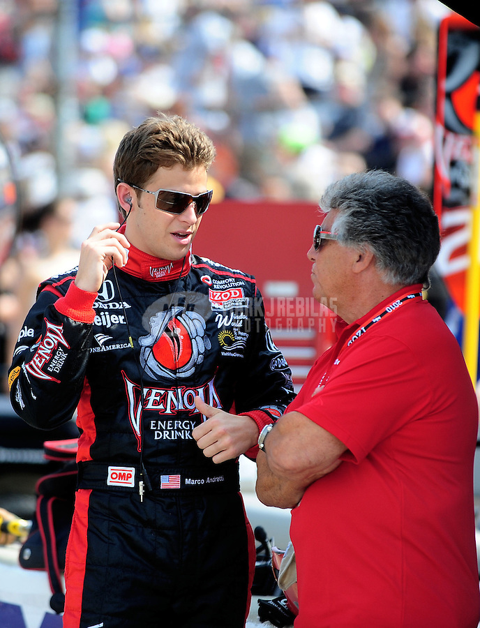 May 28, 2010; Indianapolis, IN, USA; IndyCar Series driver Marco Andretti (left) talks with grandfather Mario Andretti during carb day prior to the Indianapolis 500 at the Indianapolis Motor Speedway. Mandatory Credit: Mark J. Rebilas-