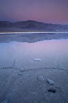 Dawn light over flooded Middle Basin salt pan, Devils Golf Course, Middle Basin, Death Valley, California