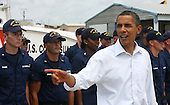 United States President Barack Obama answers questions from reporter after speaking at a Coast Guard base in Panama City, Florida USA on Saturday, 14 August  2010. The First Family is visiting the area to help promote tourism and check up on clean up efforts from the aftermath of the Deepwater Horizon Oil spill.  .Credit: Dan Anderson / Pool via CNP