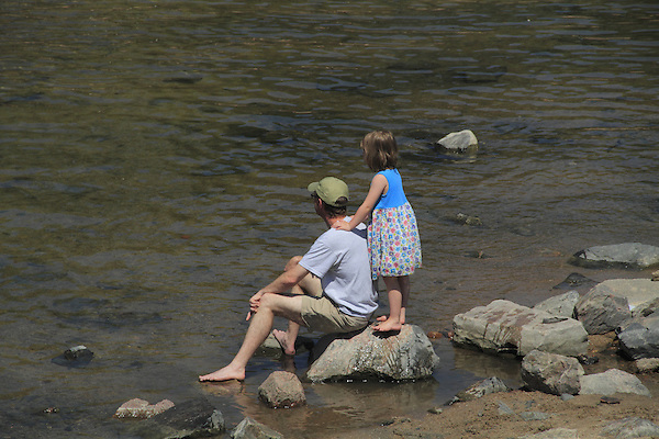 Father and daughter along the water in Boulder, Colorado. .  John offers private photo tours in Denver, Boulder and throughout Colorado. Year-round Colorado photo tours.